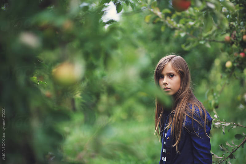 Girl In The Apple Orchard by ALICIA BOCK for Stocksy United