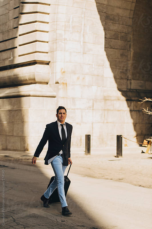 Latino Businessman on the move  by Cameron Whitman for Stocksy United