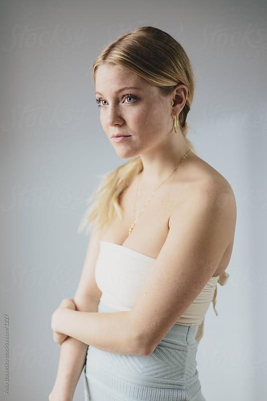 Portrait of a blonde girl by Ania Boniecka for Stocksy United