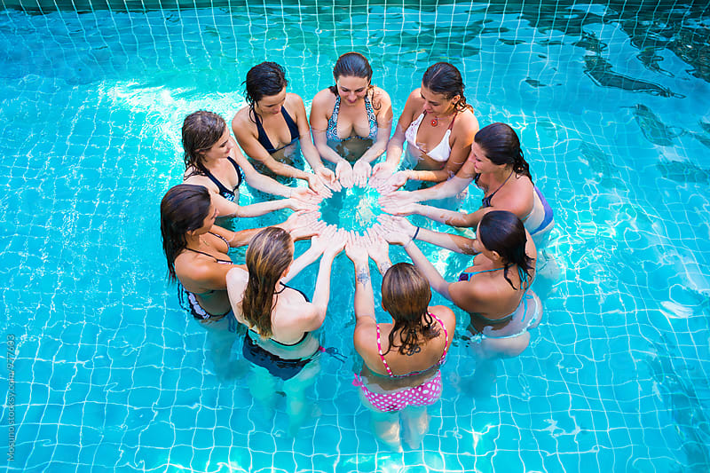 Women Playing in the Pool by Mosuno for Stocksy United