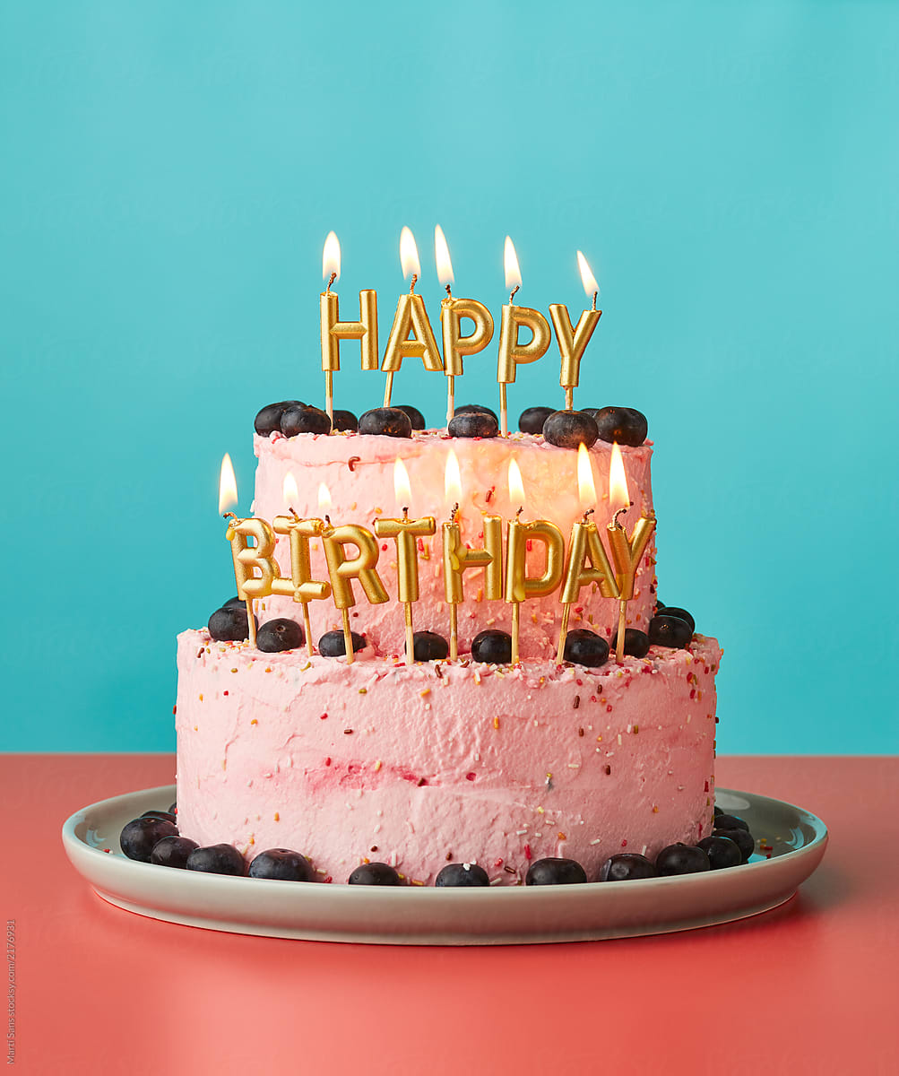 Happy Birthday Cake With Lit Candles By Marti Sans For Stocksy United