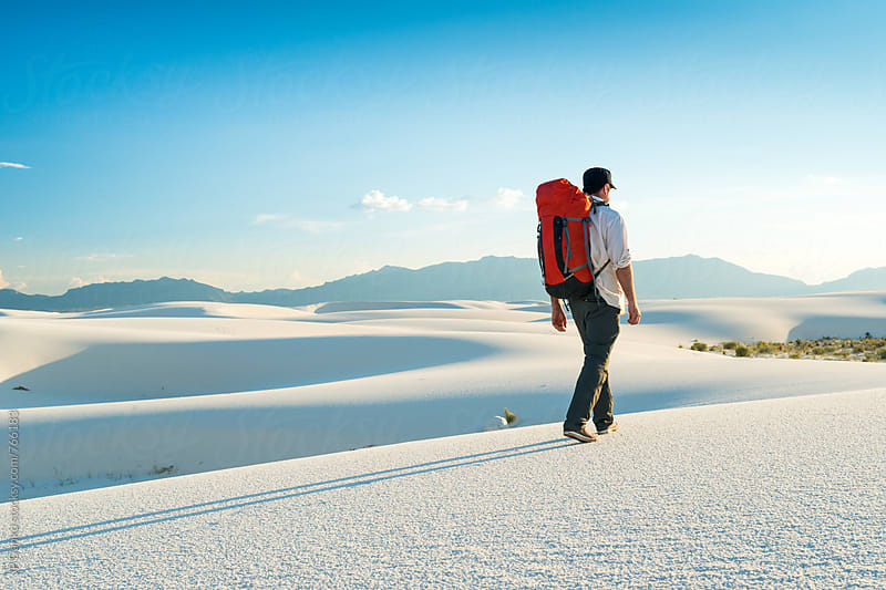 Man Camping in White Sands National Monument Hiking to Back Country Campsite by JP Danko for Stocksy United