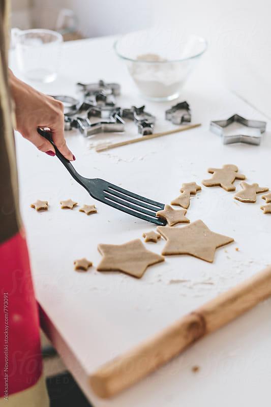 Young woman preparing christmas cookies by Aleksandar Novoselski for Stocksy United