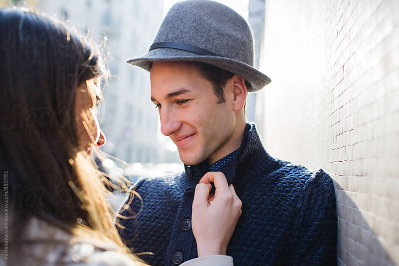 Smiling young man enjoying the sunny day with his girlfriend by michela ravasio for Stocksy United