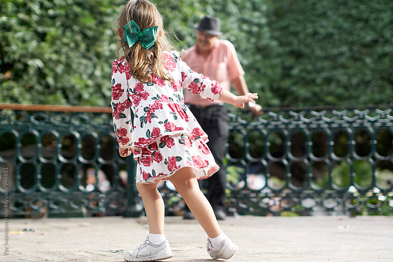 Young girl is having fun with grandpa by Per Swantesson for Stocksy United