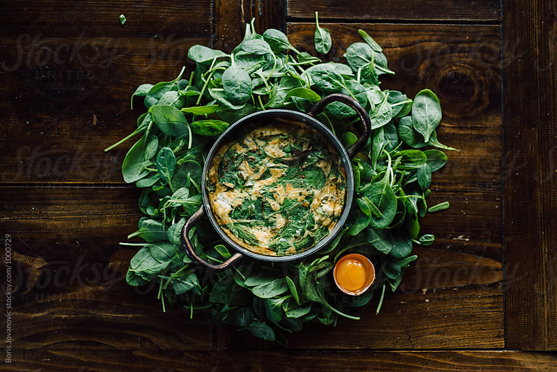 Delicious meal made of spinach and eggs  by Boris Jovanovic for Stocksy United