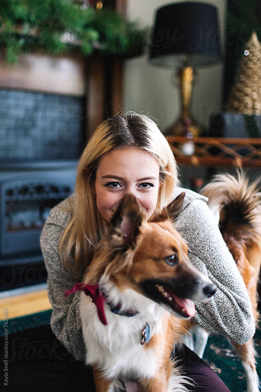 Woman cuddling with her dog by Kayla Snell for Stocksy United