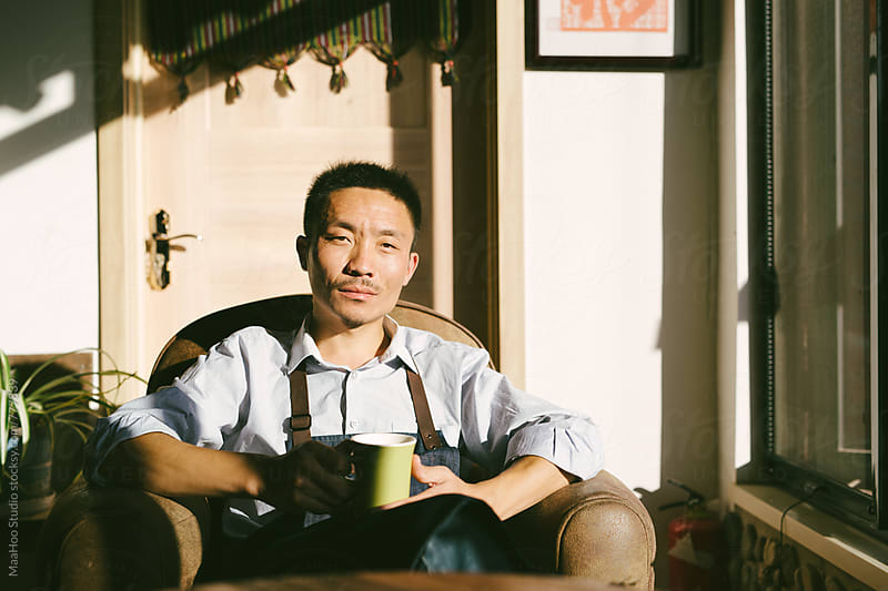 Portrait of young coffee maker by Maa Hoo for Stocksy United