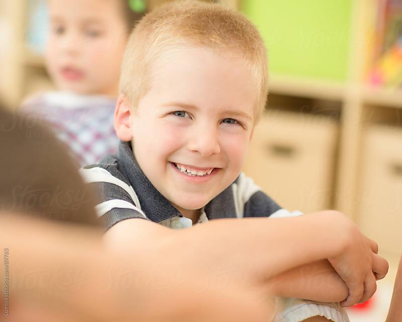 Smiling Blond Boy by Lumina for Stocksy United