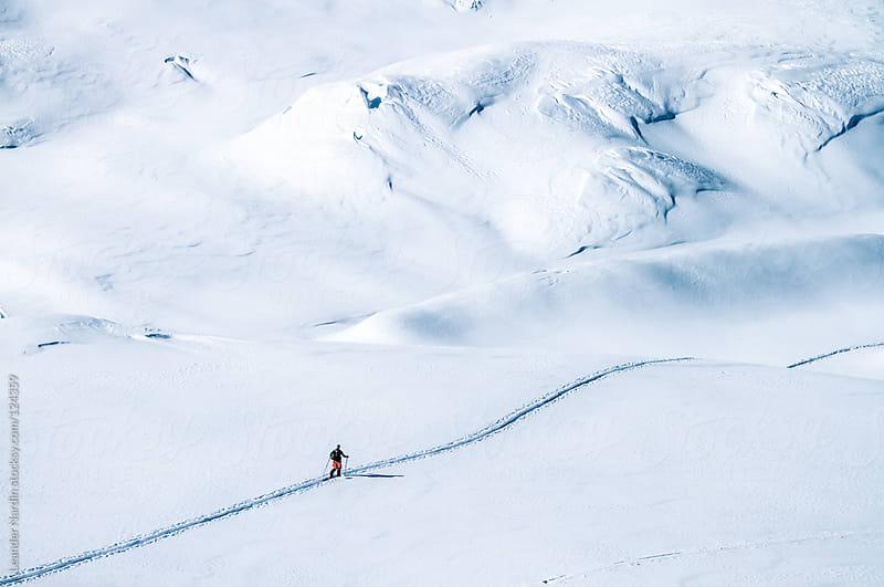 ski tourer on big mountains in a winterlandscape  by Leander Nardin for Stocksy United