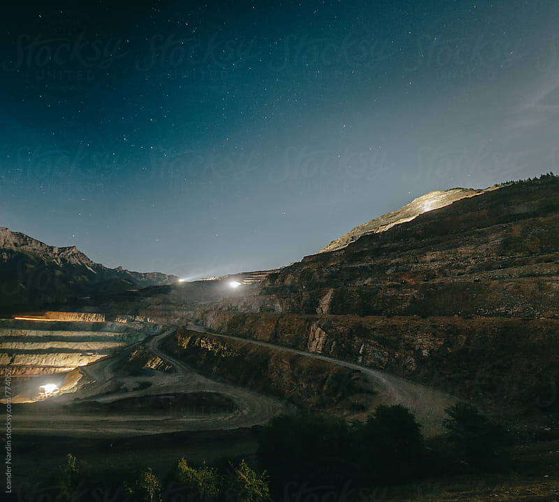 panorama night shot of a strip mining area by Leander Nardin for Stocksy United