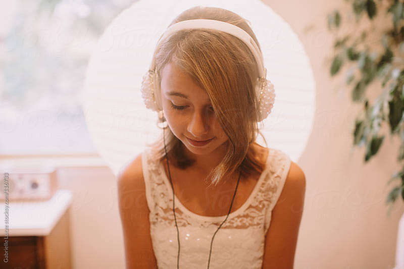 Girl with Headphones by Gabrielle Lutze for Stocksy United