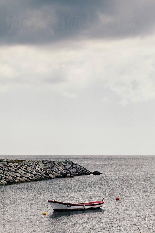 Empty boat by Borislav Zhuykov for Stocksy United