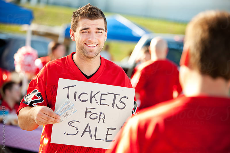 Tailgating: Looking For Someone to Buy Tickets by Sean Locke for Stocksy United