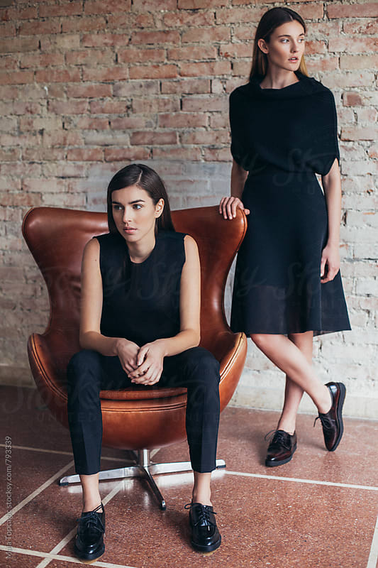 Two beautiful models standing in black clothes by Maja Topcagic for Stocksy United