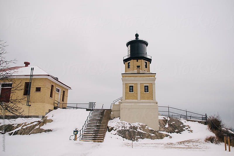 Lighthouse in winter by Justin Mullet for Stocksy United