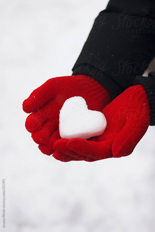 Man holding snow made heart in his hands by Jovana Rikalo for Stocksy United