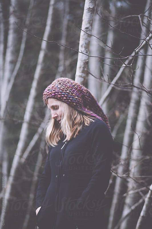 Contemplative in the woods. by Cherish Bryck for Stocksy United