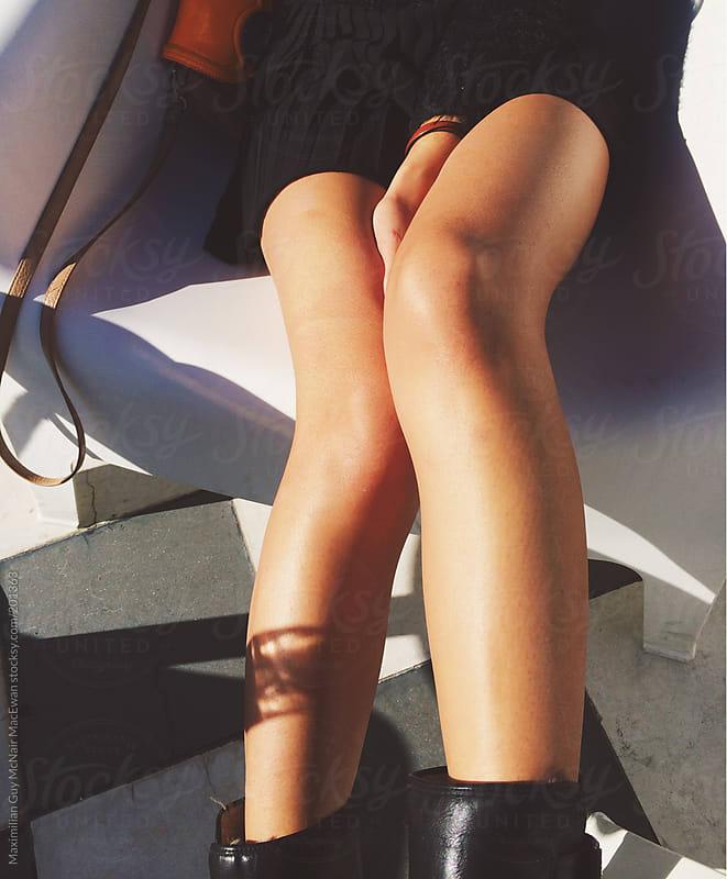 Legs in the sun by Maximilian Guy McNair MacEwan for Stocksy United