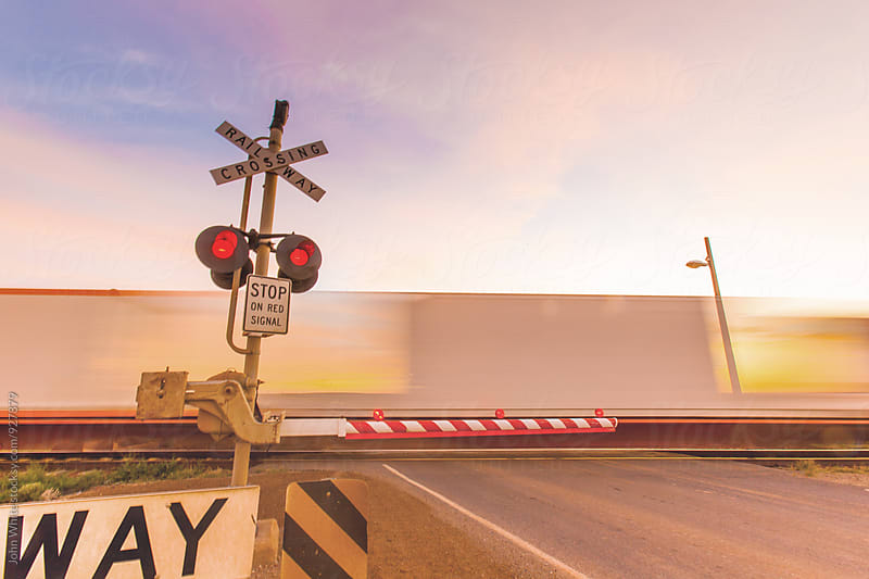 Blur of a train at a rail crossing. Outback Australia. by John White for Stocksy United