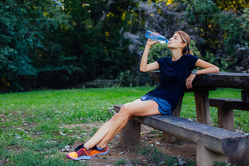 Woman Drinking Water After Exercising by Mosuno for Stocksy United