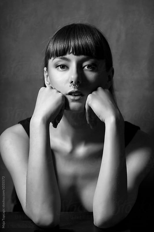 Portrait of a woman in studio by Maja Topcagic for Stocksy United