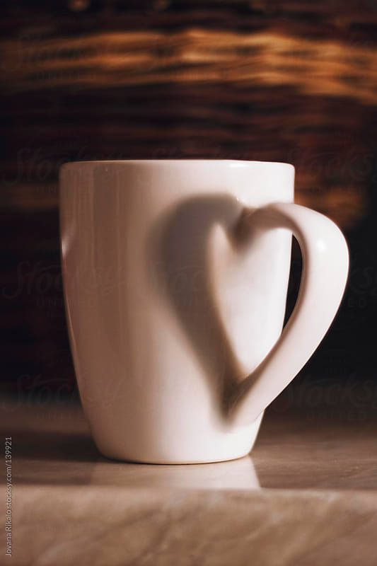 Heart shaped shadow of cup holder by Jovana Rikalo for Stocksy United