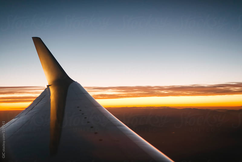 Plane wing at sunset by GIC for Stocksy United