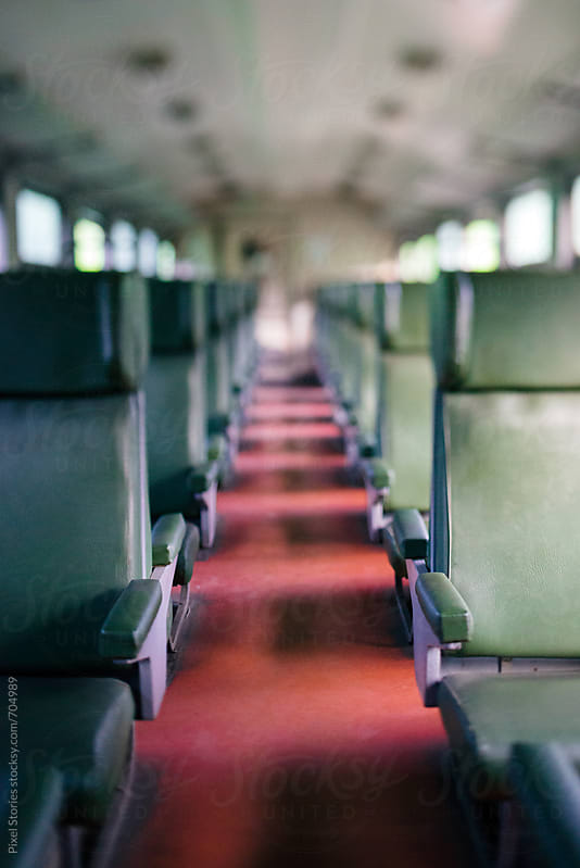 Empty seats on open type passenger train by Pixel Stories for Stocksy United