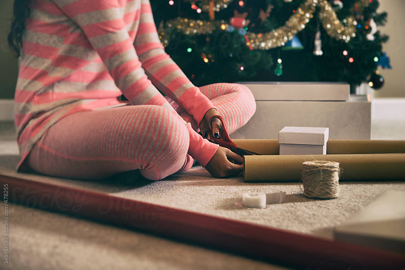 Pajamas: Woman Sitting And Wrapping Christmas Gifts by Sean Locke for Stocksy United