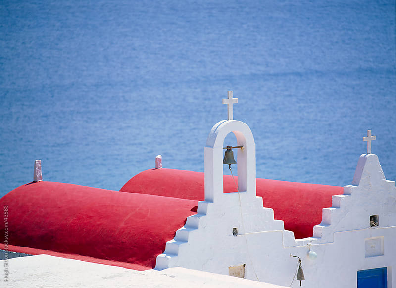Red roofs of church. Mykonos. Greece. by Hugh Sitton for Stocksy United