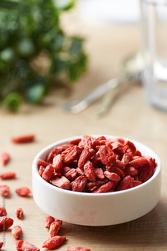 close-up of bowl of dried goji berries by Martí Sans for Stocksy United