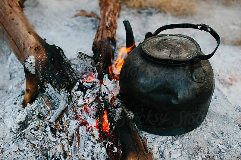 kettle on campfire in Tanzania by Cameron Zegers for Stocksy United