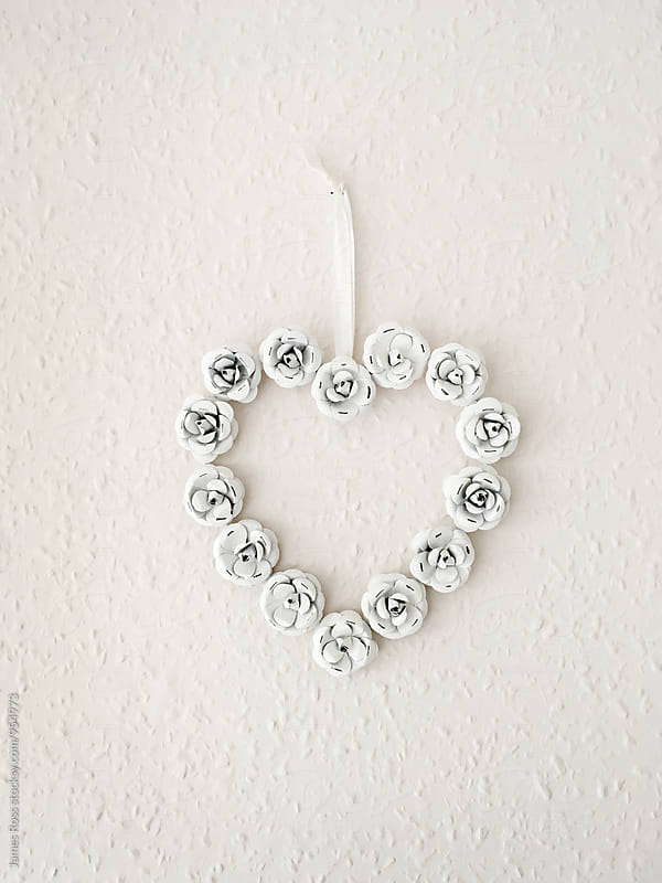 Heart shaped decoration on a wall by James Ross for Stocksy United