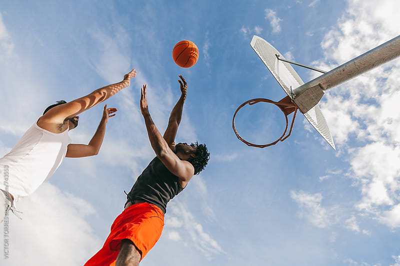 Two Friends Playing in a Street Basketball Court by VICTOR TORRES for Stocksy United