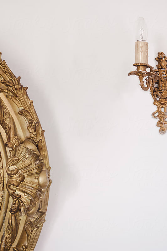 Antique golden sconce and decor by Per Swantesson for Stocksy United