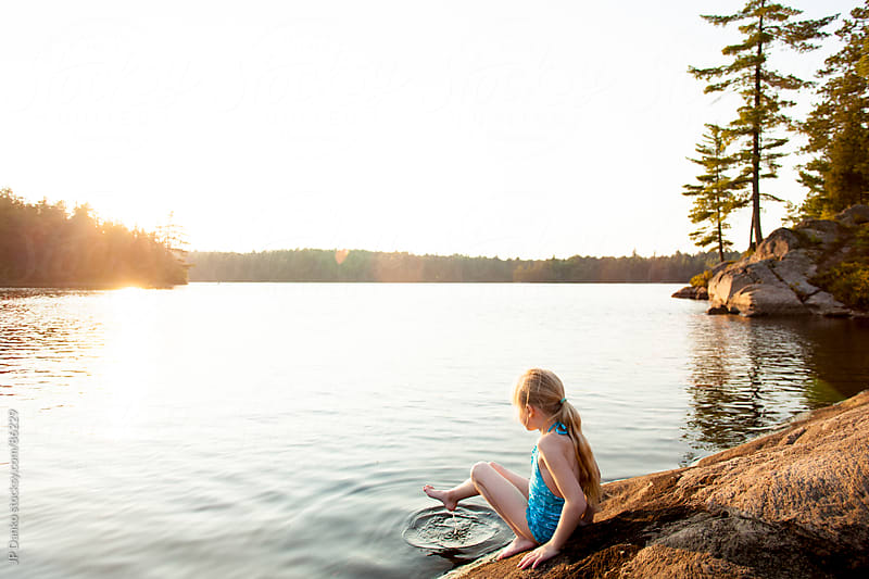 Little Girl Swimming at Lake with Summer Sunset by JP Danko for Stocksy United