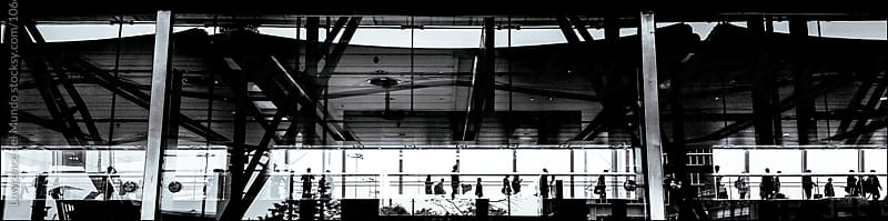 Silhouette of passengers in transit in the airport. by Lawrence del Mundo for Stocksy United