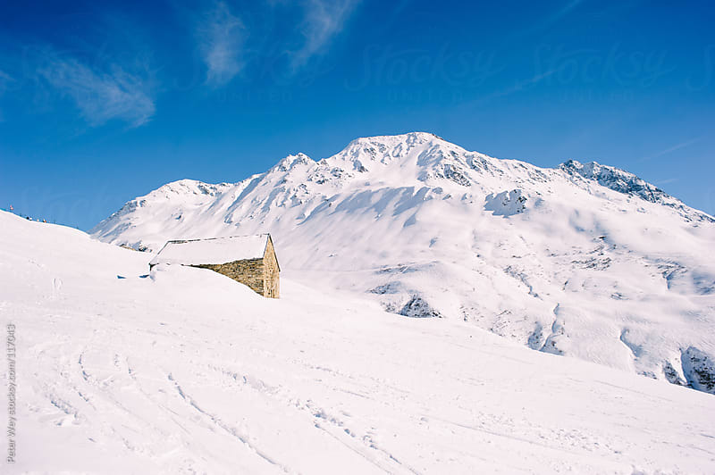 Snow covered mountains at oberalp mountain pass by Peter Wey for Stocksy United