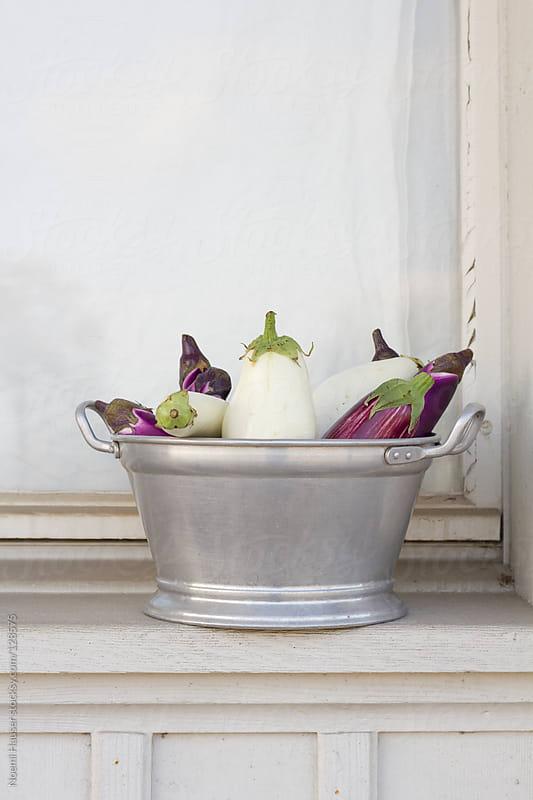 Eggplants in vintage bowl by Noemi Hauser for Stocksy United