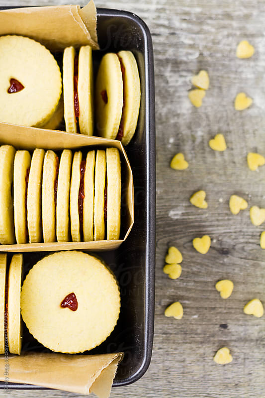 Jam Biscuits in tin offset by Kirsty Begg for Stocksy United
