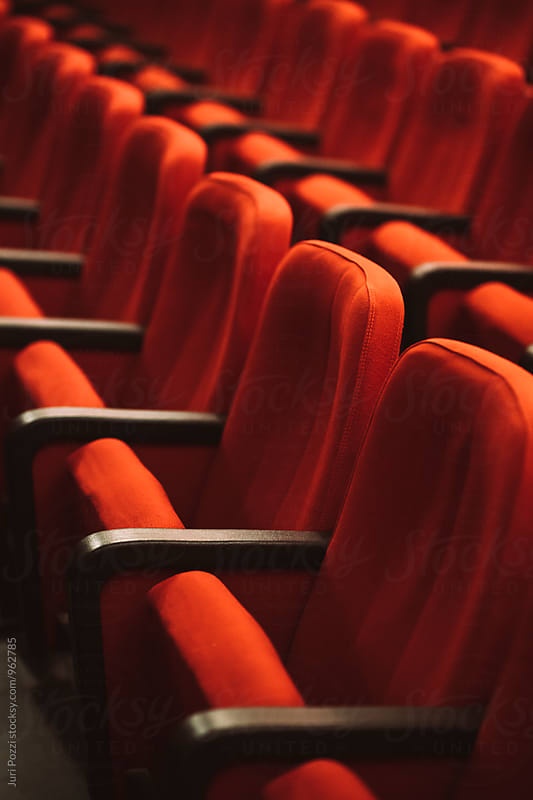 red cinema or theatre empty seats by Juri Pozzi for Stocksy United