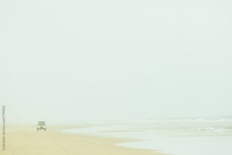 Driving down the beach in an off road 4x4 on Fraser's Island, Australia by Todd Beltz for Stocksy United