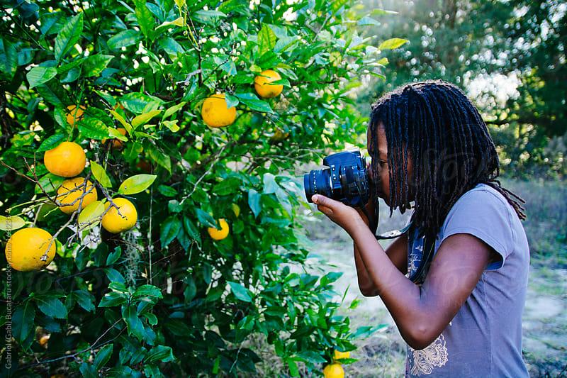 Girl With Camera by Gabriel (Gabi) Bucataru for Stocksy United