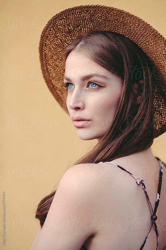 Young beautiful woman with freckles and blue eyes by Maja Topcagic for Stocksy United