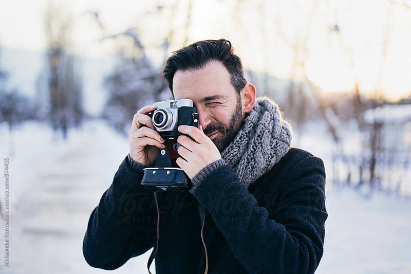 Photographer with film camera taking picture by Aleksandar Novoselski for Stocksy United