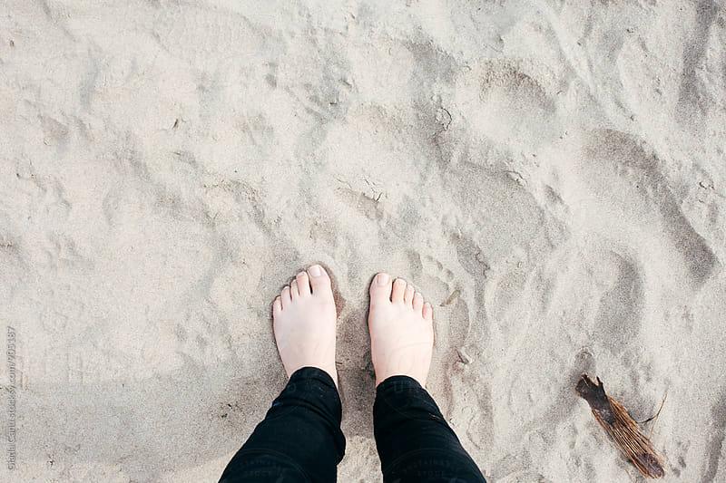 Barefoot on a sandy beach by Giada Canu for Stocksy United