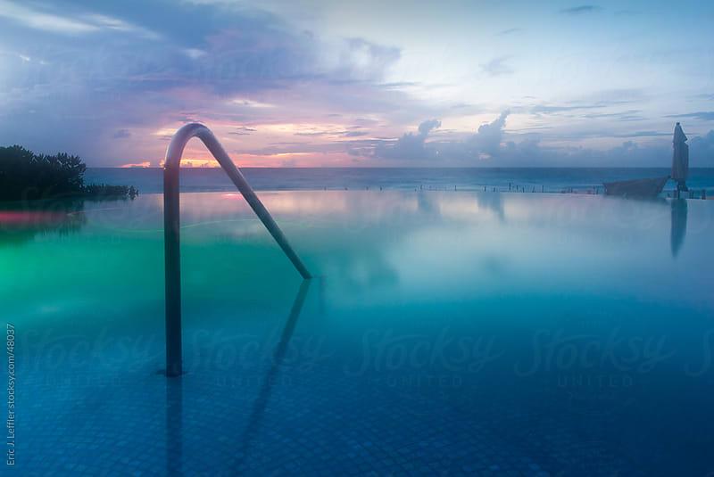 Infinity Pool Sunrise by Eric J. Leffler for Stocksy United