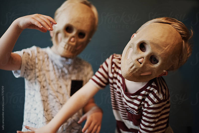 Children wearing skull masks by sally anscombe for Stocksy United