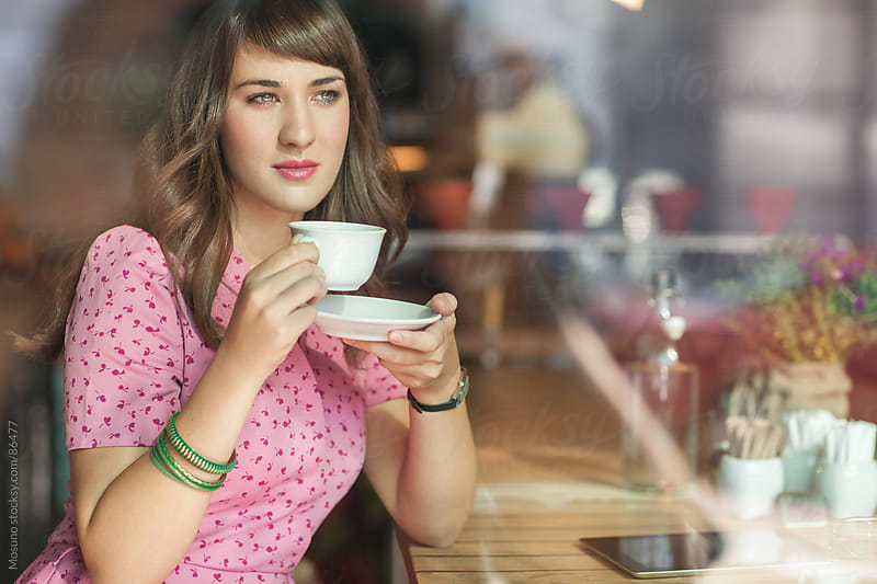 Elegant Woman Drinking Coffee in a Cafe by Mosuno for Stocksy United